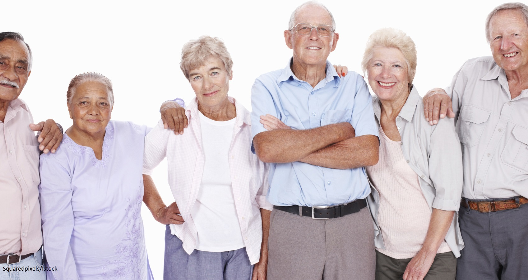 Portrait of smiling seniors standing together over white background
