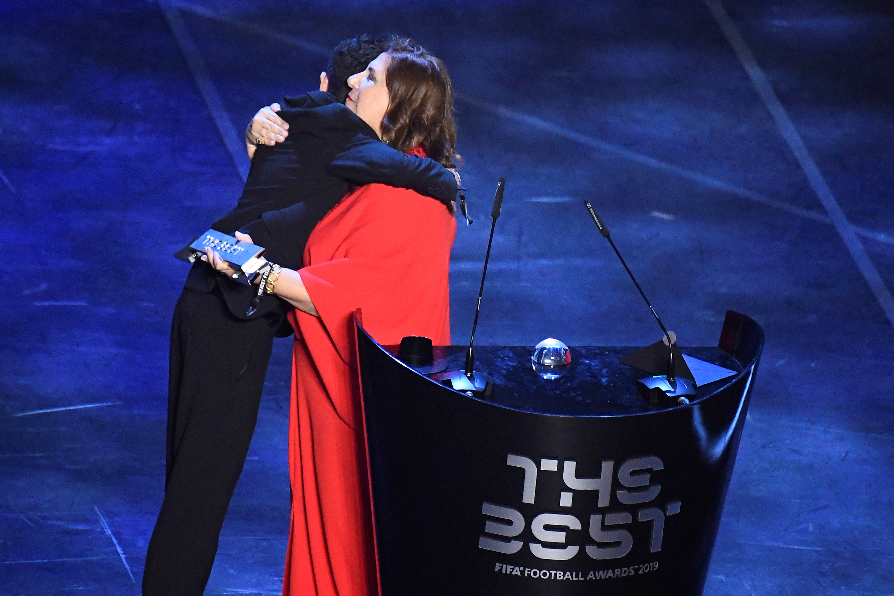 Soccer Football - The Best FIFA Football Awards - Teatro alla Scala, Milan, Italy - September 23, 2019   Silvia Grecco with her son, speaks after winning the FIFA fan award   REUTERS/Flavio Lo Scalzo